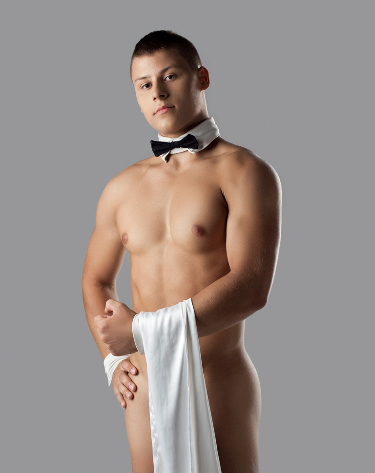 athletic man like striptease waiter hold towel